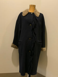 Hilary Radley navy blue 100% pure virgin wool coat with synthetic shearling collar and cuffs , pockets, button closures and a unique front fringe. Size 8.