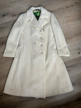 Load image into Gallery viewer, Kingspier Vintage - Miss Lodenfrey white Australian wool coat with lovely braided trim detailing, double breasted with button closures and front pockets. This coat features a bright green paisley lining. Made in Austria. Size small.