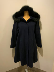 Braemar Petites by Jeremy Scott 1980's/ 1990's wool blend coat in navy blue with synthetic fur trim around the hood. Features hidden button closures down the front and slash pockets. Made in Romania
