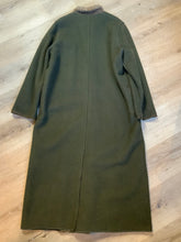 Load image into Gallery viewer, Epsilon full length moss green 100% wool coat with sheepskin panel running down the front. button closures with unique flower detail, front pockets and a zip out inside lining. Made in Canada. Fits a size large.