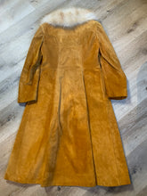 Load image into Gallery viewer, Embassy 1970's full length tan suede coat with fur collar, button closures, pockets and a salmon coloured quilted lining. Made in Montreal, Canada. Fits Small.