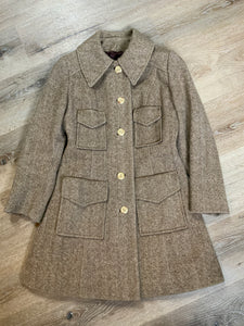 Wool herringbone car coat with front buttons and four front flap pockets. Union made in Canada.