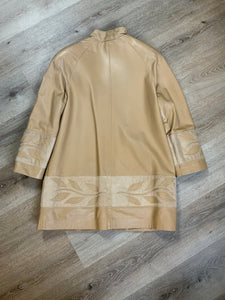 Les Fourrures Lord Inc beige coloured leather car coat with suede leaf motif at cuffs and hem, suede buttons and patch pockets.