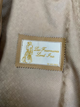 Load image into Gallery viewer, Les Fourrures Lord Inc beige coloured leather car coat with suede leaf motif at cuffs and hem, suede buttons and patch pockets.