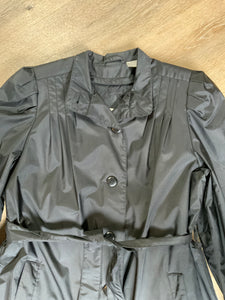 J.Gallery Petite water repellent black single breasted trench coat with belt, button closures, welt pockets. pleated detail in shoulders and zip out quilted lining. Size 12 petite.
