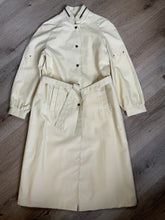 Load image into Gallery viewer, Westfield single breasted trench coat in cream with belt, snap closures, welt pockets and zip detail in collar. Made in Winnipeg, Canada. NWT, Size 8.