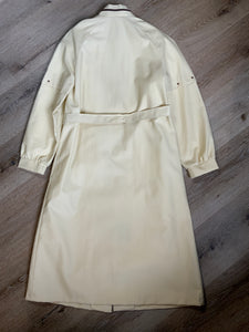 Westfield single breasted trench coat in cream with belt, snap closures, welt pockets and zip detail in collar. Made in Winnipeg, Canada. NWT, Size 8.