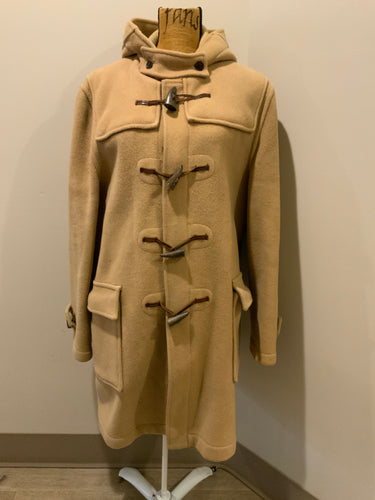 Gloverall tan wool duffle coat with hood, zipper, wooden toggles and flap pockets. Made in England. Size 50L.