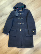 Load image into Gallery viewer, Gloverall navy blue wool duffle coat with hood, zipper, wooden toggles, flap pockets and green plaid lining. Made in England.