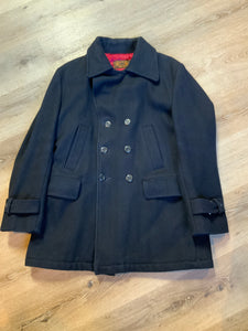 The Bay navy blue wool blend peacoat with front welt pockets and flap pockets plus a raspberry colour quilted lining. Made in Canada. Size 40.