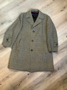 Tweed light brown wool blend car coat with slash pockets, dark brown button closures, dark brown iridescent satin lining with inside pocket and wine trim. Size 50.