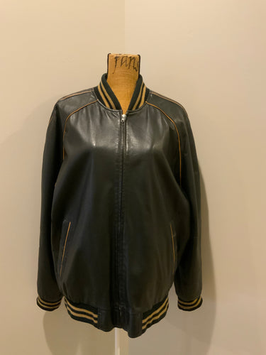 Kingspier Vintage - Retreat circa early 2000's black leather bomber jacket with light brown stripe detailing, front zipper, slash front pockets and two inside pockets. Size 44.