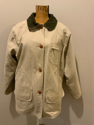 L.L.Bean beige field jacket with green corduroy collar and cuff, four front patch pockets and one zip pocket, button closures, removable plaid