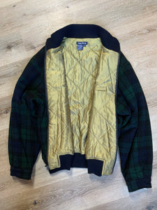 "Kingspier Vintage - Nautica green and black ""black watch"" tartan wool jacket with knit trim collar, zipper, slash pockets and quilted lining. Size XL."