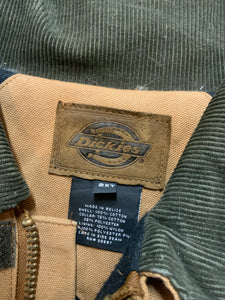 Dickies canvas work jacket with green corduroy collar, patch pockets, zipper, Velcro closures, quilted lining, an inside drawstring at the waist and an inside pocket.