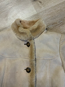 Montreal Leather Garment Sheepskin coat with shearling trim and lining, button closures and slash pockets.
