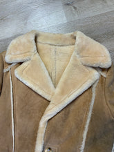 Load image into Gallery viewer, Leather Attic light brown sheepskin coat with shearling trim and lining, button closures and patch pockets.