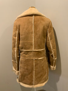 Leather Attic light brown sheepskin coat with shearling trim and lining, button closures and patch pockets.