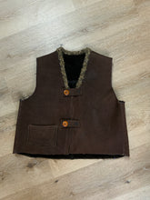 Load image into Gallery viewer, Brown sheepskin vest with two wooden button closures, one patch pocket and a knit mohair collar.