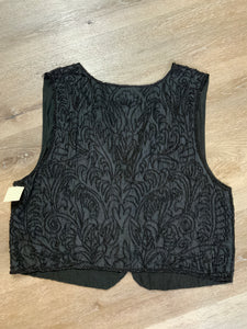 Black beaded vest with hook and eye closures.