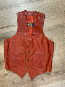 Rival rust leather vest with snap closures and patch pockets.