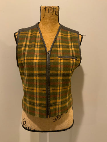Casual Corner green plaid wool vest with leather trim and details, zipper closure, one zip pocket on the chest and a quilted lining. Size 8.