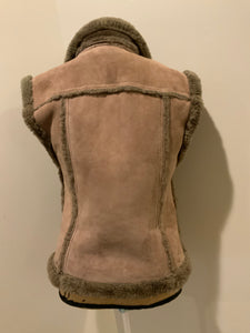 Anne Klein brown shearling vest with shearling trim and zipper closure.