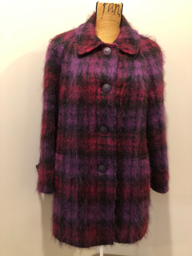 Kingspier Vintage - Fashion Gallery 1990's Mohair/Wool blend purple and pink plaid jacket. This jacket features front welt pockets, four large iridescent purple buttons and black satin lining. Size 12.