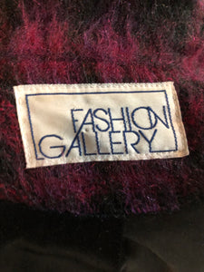 Fashion Gallery 1990's Mohair/Wool blend purple and pink plaid jacket. This jacket features front welt pockets, four large iridescent purple buttons and black satin lining. Size 12.