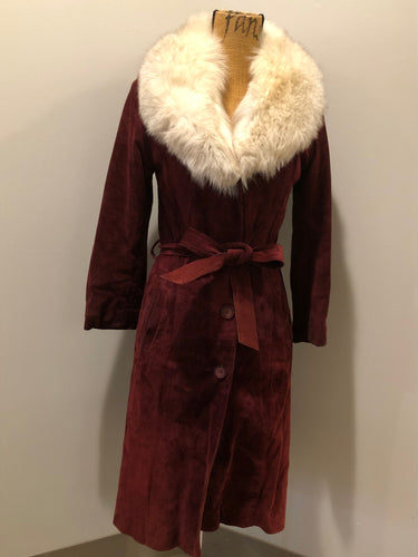 Kingspier Vintage - Leather Attic 1970's oxblood suede coat with fur collar. Beautifully fitted, the coat features pockets, buttons, a belt and a quilted lining. Made in Canada. Size small.