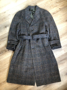 Evolution grey, black, burgundy and Brown plaid Italian wool mohair blend double breasted coat with welt pockets and belt. The coat is fully lined with two inside pockets. Fits large.