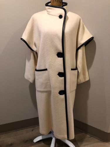 Kingspier Vintage - Genuine Hudson Bay Company 100% virgin wool coat in white with black leather trim, front pockets, flat black buttons and a unique mandarin collar with cape style detail around shoulders. Contains a Hudson's Bay seal of quality tag. Made in Canada.