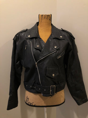 Kingspier Vintage - Cosa Nova black leather motorcycle jacket with two slash pockets, one flap pocket and a belt at the waist. Made in Canada. Size large.