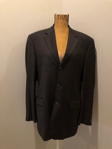 Kingspier Vintage - Bill Blass dark brown 100% pure wool two piece suit. The jacket is a single breasted three button notch lapel with two flap pockets and a beige lining with two inside pockets, Pants are pleated with welt pockets.