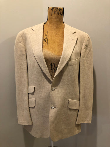 Kingspier Vintage - Chaps by Ralph Lauren light beige two piece suit sold at Martini Carl Boston. Jacket is a three button notch lapel with three flap pockets and a breast pocket. The pants are flat front with two slash pockets, a tiny flap pocket in the front and two back pockets.