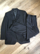 Load image into Gallery viewer, JoS. A. Bank, Signature Collection dark grey 100% wool two piece suit. Made in Mexico. Jacket is a three button notch lapel with two flap pockets and a breast pocket, three inside pockets and one coin pocket. Pants are pleated and cuffed with welt pockets in front and back and suspender buttons.
