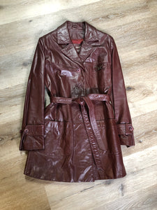 "Etienne Aguier burgundy leather jacket with button closures, patch pockets, belt and ""A"" decorative details. Size small."
