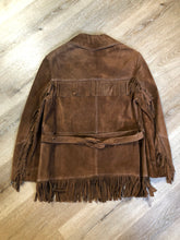 Load image into Gallery viewer, Jonathan Legault brown suede western style jacket with fringe details, belt in the back, button closures and slash pockets.