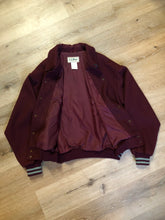 Load image into Gallery viewer, L.L.Bean bomber jacket in wine with snap closures with logo, knit trim and slash pockets. Size large.