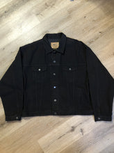 Load image into Gallery viewer, Kingspier Vintage - International Denim black denim jacket with button closures, two vertical pockets, two flap pockets and two inside pockets. Made in Canada. Size XXXL.