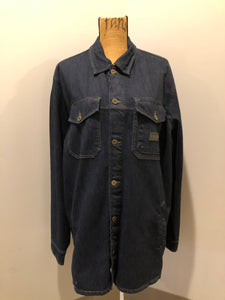 Kingspier Vintage - ATF (Analog Technical Fashion) denim jacket in a dark wash with button closures, two zip slash pockets, two flap pockets, an inside pocket and a plaid lining. Union made. Size XL.