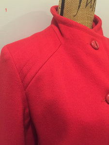 Electre Paris red wool car coat with red button closures, welt pockets and subtle detailing on shoulders. Made in Canada