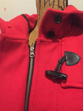 Load image into Gallery viewer, Hudson's Bay Company official 2014 Olympics duffle coat in red with hood, toggles, zipper and flap pockets. Size is small.