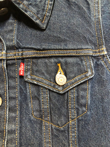 Levi's Original Trucker Jacket in a medium wash denim with Canada leaf patch on the left shoulder, button closures, two vertical pockets and two flap pockets on the chest. Size XS.