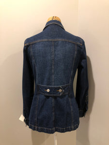 Isaac Mizrahi denim safari style jacket in a dark wash with belt in the back, button closures, four flap pockets and two hand warmer pockets. Size small.