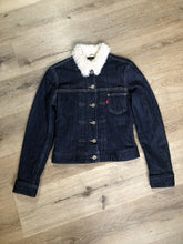 Load image into Gallery viewer, Levi's Sherpa style denim jacket in a dark wash with stretch, pleats running down the front, faux fur lining and quilted lining in both arms, button closures and one patch pocket. Size XS.