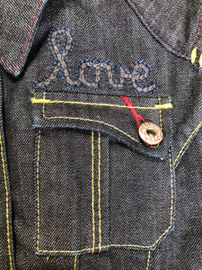 People for Peace cropped denim jacket in a dark wash with colourful embroidery all over, button closures, two zip pockets and two flap pockets on the chest. Size small.