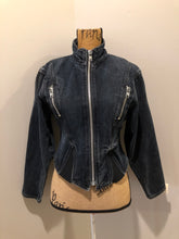 Load image into Gallery viewer, Santana denim jacket in faded black with elastic sections to hug the body, zipper and zip vertical pockets. Made in Canada. Size medium
