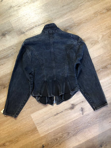Santana denim jacket in faded black with elastic sections to hug the body, zipper and zip vertical pockets. Made in Canada. Size medium