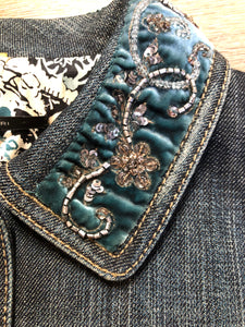 Elie Tahari denim jacket in a faded dark wash with beaded velvet collar, decorative snap closures, deep green velvet belt and a beautiful patterned silk lining.  Size small.